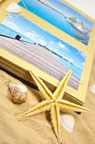 Photoalbum with souvenirs and shells with sand royalty free stock photos