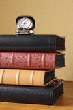 Photoalbums and clock Royalty Free Stock Photos