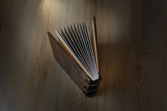 Photobook on a wooden background Stock Image