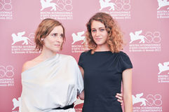 Photocall - 68° Mostra del Cinema di Venezia, September - Italy. VENICE - SEPTEMBER 3: Actress Aggeliki Papoulia and Ariane Labed poses at photocall during Stock Photos
