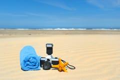 Photocamera каникул пляжа стоковые изображения