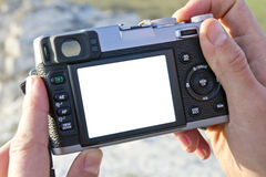 Photocamera in a hands. Man hands with a digital compact photocamera stock photo