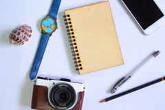 Photocamera and notebook flat lay on white background. Summer travel banner template. Hipster gadgets. Holiday travel hero header. Vintage notepad with wooden Royalty Free Stock Image