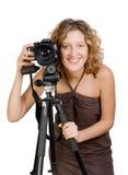 Photocamera sonriente hermoso joven de la explotación agrícola de la mujer fotografía de archivo