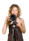 Photocamera sonriente hermoso joven de la explotación agrícola de la mujer imagen de archivo