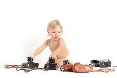 photocameras младенца старые белые Стоковая Фотография