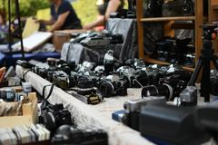 Photocameras in London flea market, horizontal. royalty free stock photos
