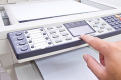 Photocopy machine. Hand pressing button photocopy machine Royalty Free Stock Images