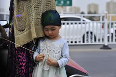 The Uyghur nationality young kid royalty free stock photos