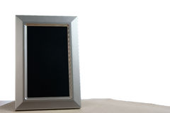 Photoframe. Silver photoframe on the table in white background Royalty Free Stock Photography