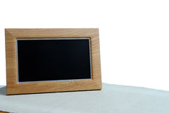Photoframe. Clean photoframe on the table in white background Stock Images