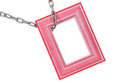 Photoframe. A photoframe on chain on white Royalty Free Stock Image