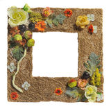 Photoframe adorned with artificial flowers Stock Photo