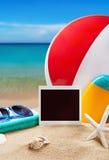 Photoframe and beach gear Stock Photo