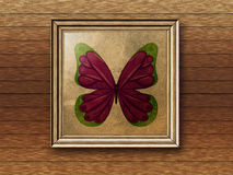 Photoframe with butterfly. Vintage wooden photo frame with drawing of butterfly on wall background Royalty Free Stock Image