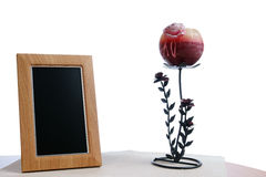 Photoframe and candlestick. Candlestick and photoframe on the table in white background Stock Image