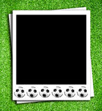 Photoframe com esfera de futebol Fotos de Stock Royalty Free