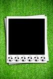 Photoframe com esfera de futebol Fotos de Stock