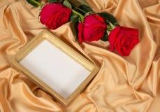 Photoframe com rosas Fotos de Stock