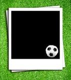 Photoframe con el balón de fútbol Imagen de archivo libre de regalías
