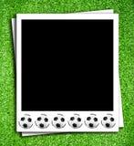Photoframe con el balón de fútbol Fotos de archivo libres de regalías