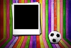 Photoframe e esfera de futebol Fotografia de Stock Royalty Free