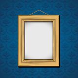 Photoframe hanging on the wall with blue wallpaper Stock Images