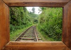 Photoframe for the memory about traveling. Beautiful tropical landscape with railway trucks in lush of green under hills. Of Sri Lanka or India Stock Photos
