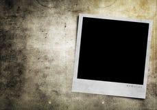 Photoframe op grungeachtergrond Royalty-vrije Stock Foto's