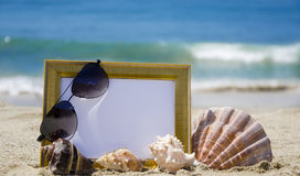Photoframe on sandy beach Stock Photo