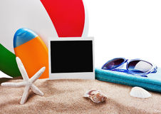 Photoframe, towel and sunglasses. And other accessories for the beach royalty free stock images