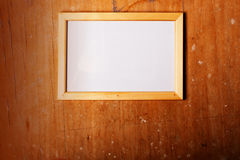Photoframe on wooden background Royalty Free Stock Image