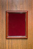Photoframe on a wooden wall Stock Image