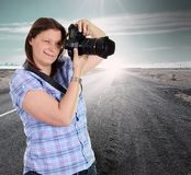 Photograher woman on the road. A photograher woman on the road stock photos