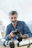 Photograher working on post production. Photo reporter working in office royalty free stock photos
