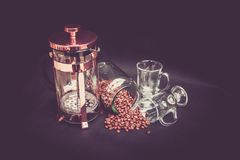 Photograhy of Brown Beans, Clear Glass Mug, and Brass Coffee Grinder Royalty Free Stock Photos