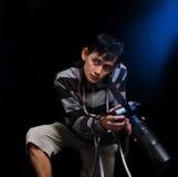 Photograper. Portrait of photograper on black Stock Photography