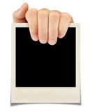 Photograph. A hand holding a photograph.  on a white background Stock Image