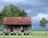 Photograph of an abandoned house in a field with a Royalty Free Stock Images