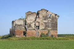 Photograph of an abandoned, weathered home found standing Stock Image