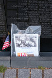 Photograph and american flag left as tributes at the Vietnam Vet Royalty Free Stock Image