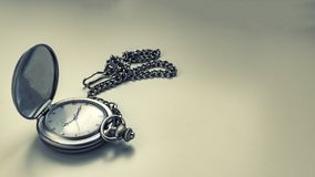 Photograph of antique clock with chain. stock images