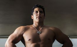 Photograph of athlete in contrapicado to highlight the volume of his body. stock photography