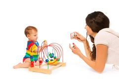 Photograph baby playing Royalty Free Stock Images