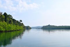 Backwater with Greenery on both Banks with Clear Water and Sky - River on Great Andaman Trunk Road, Baratang Island, India. This is a photograph of backwater royalty free stock photo