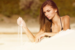 Photograph of a beautiful woman on the beach. Portrait series of girls in nature Stock Photography