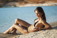 Photograph of a beautiful woman on the beach. Portrait series of girls in nature Stock Photos