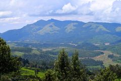 Blue Mountains with Green Valley and Cloudy Sky - Natural Munnar Kerala Landscape Background royalty free stock photography