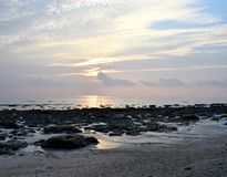 Golden Sunlight with Pattern in White Clouds in Morning Sky at Rocky Beach - Kalapathar, Havelock, Andaman - Natural Background. This is a photograph of bright stock photos