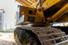 Photograph of a scraper parked in the farmhouse Royalty Free Stock Images